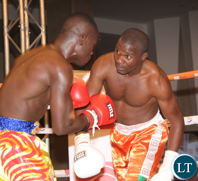 Charles Manyuchi sending Tanzanina boxer Deogratias Samwel to the canvas during the fight