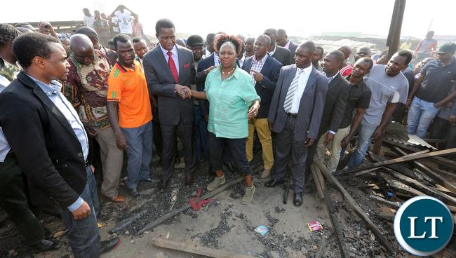 President Edgar Lungu with Mrs Mwanakatwe MP Lusala Central  tour Bauleni Market Burned