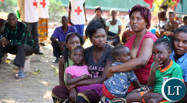 Redcross at Namwala looking after Victims camped at Secondary School.