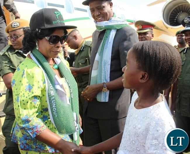 FIRST Lady, Esther Lung, talks to nine years old Esther Phiri after she presented a bouquet of flowers to President Edgar Lungu on arrival at Mfuwe International airport on Wednesday. Mr. Lungu was in Mambwe for a campaign meeting.