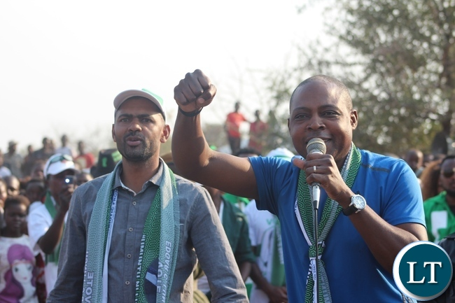 FORMER Football Association of Zambia (FAZ) President, Kalusha Bwalya, speaking during a rally addressed by President Edgar Lungu at cropping area in Malambo constituency on Wednesday. Next to him is Sports Minister, Vincent Mwale who is also Chipangali constituency PF aspiring candadite