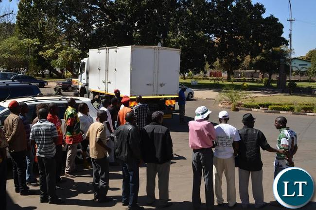 An Electoral Commission of Zambia truck carrying ballot papers for Livingstone reversing at the Civic Centre in the tourist capital as various stakeholders watch