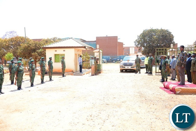 Zambia Correctional Services mounted Guard of honour to President Edgar Lungu (r) shortly before the donation of goods to the inmates