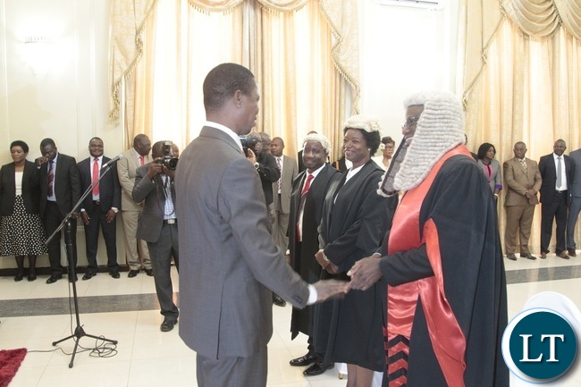 President Edgar Lungu chats with Speaker of the National Assembly Patrick Matibini(right) First Speaker of the National Assembly Catherine Namugala and Newly appointed second Speaker of the National Assembly Mwemba Malama during swearing in Ceremony