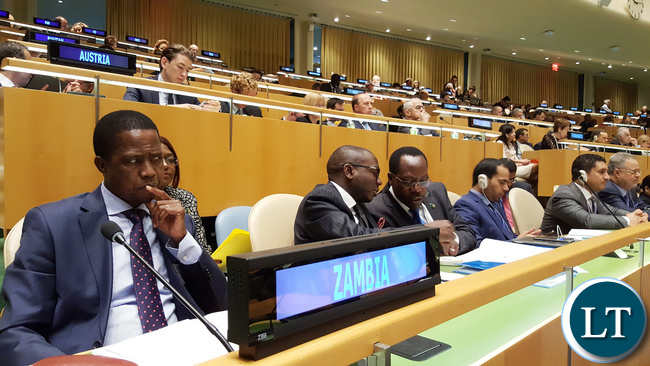 Mr. Edgar Chagwa Lungu, President of the Republic of Zambia, at the official opening of the High-Level Meeting on addressing Large Movements of Refugees and Migrants, in the United Nations General Assembly Hall in New York USA on Monday 19 September, 2016. With him is Foreign Affairs Permanent Secretary Ambassador Chalwe Lombe (centre) and the President's Political Advisor Kaizar Zulu (right).  PHOTO | CHIBAULA D. SILWAMBA | ZAMBIA UN MISSION