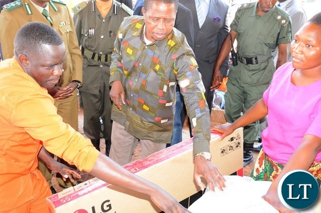 President Edgar Lungu handing over Television set to inmates during the donated goods