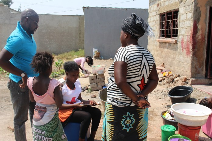 A-Family-in-Chaisa-compound-Listening-to-Messages-for-Measles-and-Rubella-vaccination-by-Zambia-Red-Cross-Volunteers