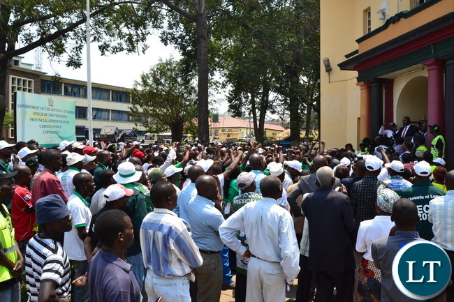 Copperbelt Minister Bowman Lusambo addresses an impromtu crowd of his supporters that converged outside the Provicial Administration Buildings to welcome him after he reported for duty