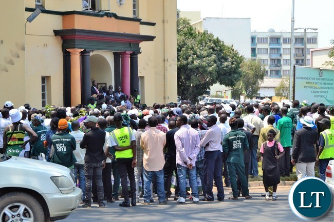 Copperbelt Minister Bowman Lusambo greets his supporters who converged outside the Provicial Administration Buildings to welcome him after he reported for duty