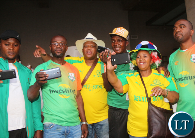 Rival Supporters mingling taking  selfies