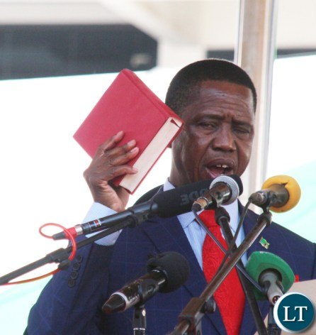 President Edgar Chagwa Lungu Being Sworn by Her ladyship Mrs Irene C Mambili Chief Justice of Zambia at Inaguration ceremony at Heroes Stadium in Lusaka
