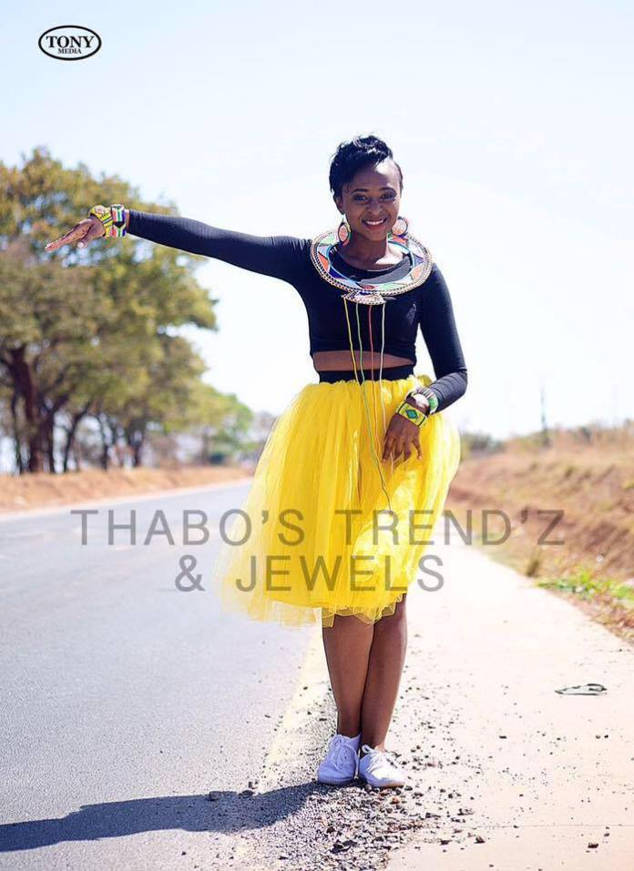 Thabo wearing her designs