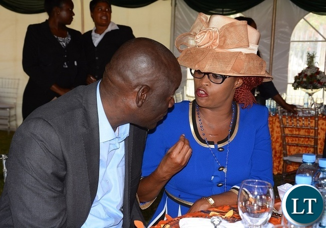 Former Minister of Home Affairs, Davis Mwila confers with Patriotic Front Deputy National Secretary,Mumbi Phiri during the Luncheon at State House.
