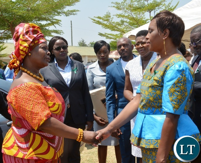 First Lady Esther Lungu(l) with North mead Primary School Headmistress Sylvia Mulyata(r) during  Giacomo Global Hand Washing Day at North mead Primary Schoo