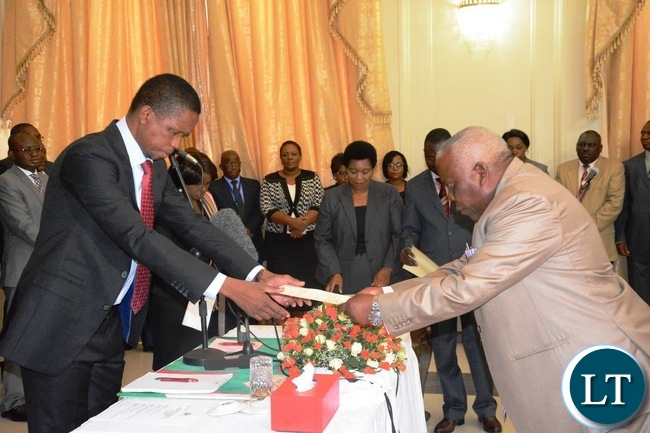 President Edgar Lungu(l) swears in Freedom Sikazwe(r) as Presidential Affairs Minister of State House during the Swearing in Ceremony at State House