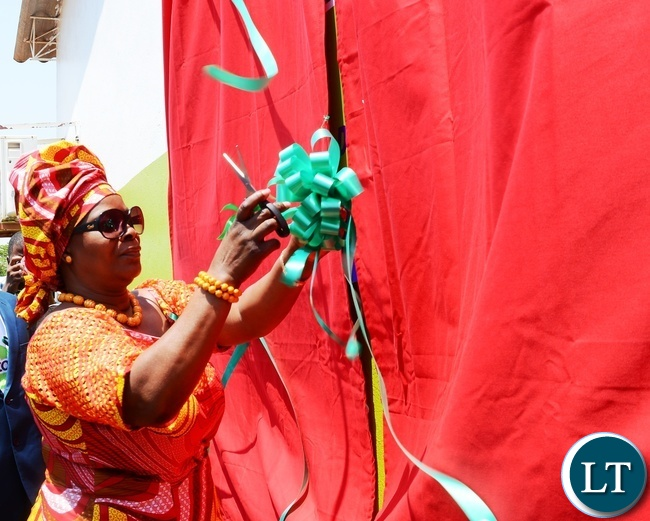 First Lady Esther Lungu cuts the ribbon to officially open the Esther Lungu Administration Block at  North mead Primary School during the Giacomo Global Hand Washing Day
