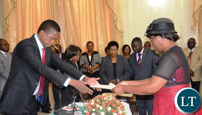 President Edgar Lungu(l) swears in Sylvia Chalikosa as Minister in the Office of the Vice President at State House