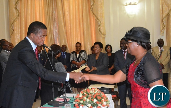 President Edgar Lungu(l) congratulates newly appointed Minister in the Office of the Vice President Sylvia Chalikosa at State House