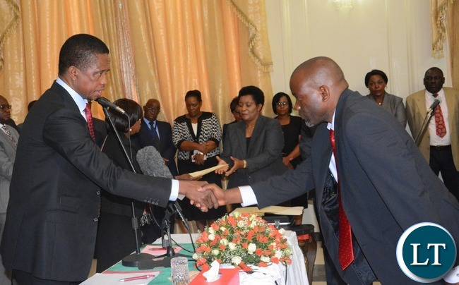 President Edgar Lungu(l) congratulates newly appointed Minister of Water and Sanitation  Loyd Kaziya  during the Swearing in Ceremony