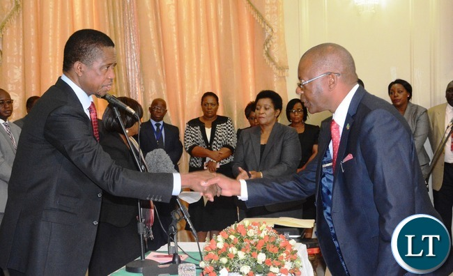 President Edgar Lungu(l) swears in Matthew Nkhuwa as Minister of Works and Supply during the Swearing in Ceremony at State House