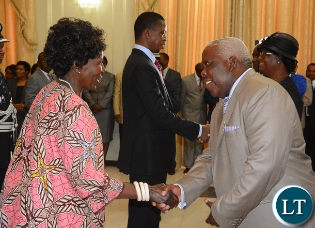 Vice President Inonge Wina(l) the newly appointed Minister of Presidential Affairs(State House)  Freedom Sikazwe(r) during the Swearing in Ceremony at State House