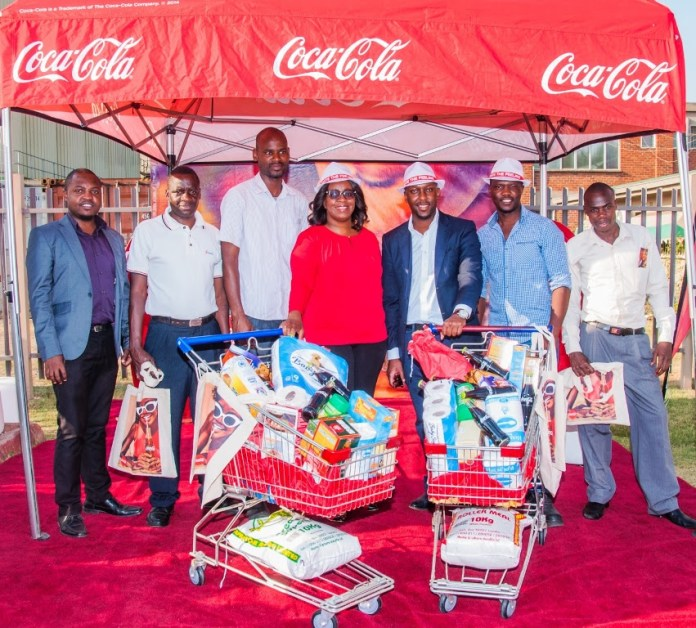 Coca-Cola Marketing Activations Manager for Zambia and, Malawi, Takunda Jinda and Zambian Breweries Marketing Manager Mambo Mwiimbu (centre) with trolley dash launch winners.