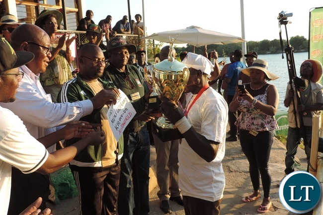 .Minister of Youth,Sport and Child Development Moses Mawere(second left) presents medals to Auto world men's winning team as Southern Province Permanent Secretary Sibanje Simuchoba(first left) looks on during the 2016 Regatta in Livingstone