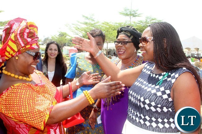 First Lady Esther Lungu embraces former First Lady Maureen Mwanawasa on arrival at Northmead Primary school for the Commemoration of Global Handwashing Day in Lusaka on Wednesday, October 12,2016-Picture by THOMAS NSAMA