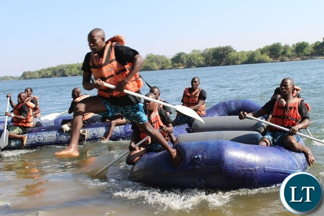 Auto World team captain jumps off the raft during the 2016 Regatta in Livingstone