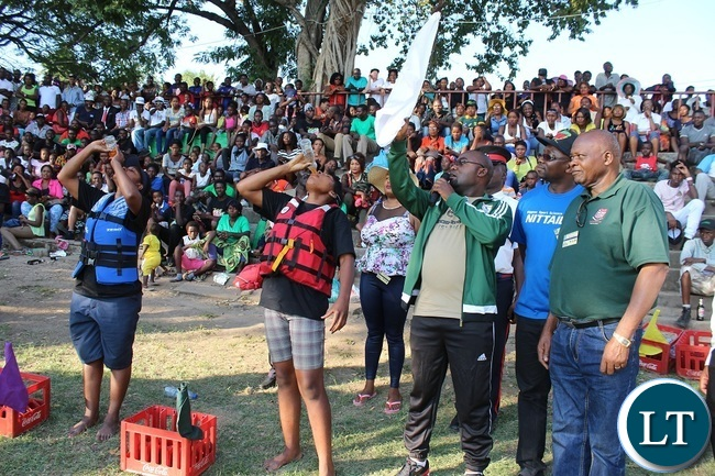 Minister of Youth,Sport and Child Development Moses Mawere (third right) flags off the women's final race during the 2016 Regatta in Livingstone