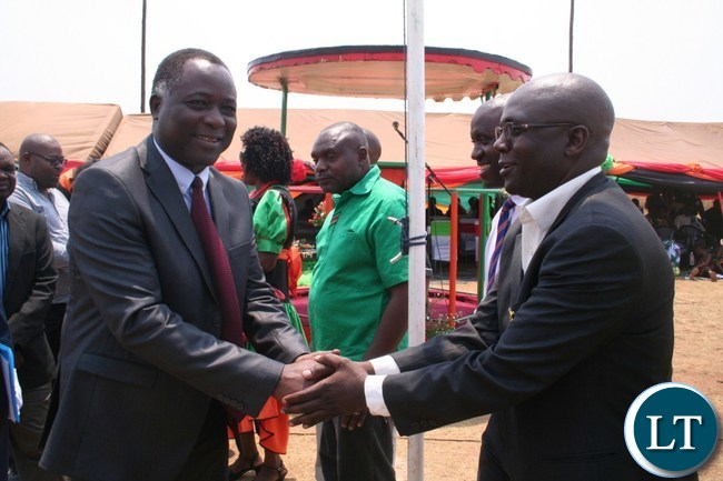 North-Western province minister Richard Kapita (l) is welcomed by Provincial Youth Development Coordinator DamianoChishimba (r) at Solwezi Stadium during the Independence celebrations