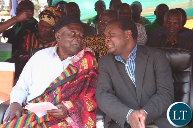 North- Western province freedom fighters chairman BwangaWisamba (l) chats with provincial deputy permanent secretary Alfred Chingi during the commemoration of 52ndIndependence at Solwezi Stadium