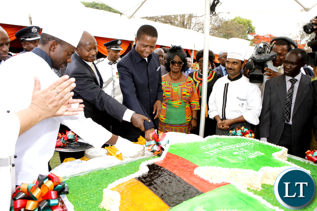 President Edgar Lungu and his Uganda's Counterpart Yoweri Museveni cutting a cake as First Lady Esther Lungu looks on during Zambia's 52nd Anniversary Celebrations at State House in Lusaka on Monday, October 24,2016 -Picture by THOMAS NSAMA