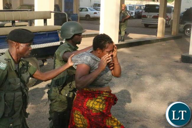 Police officers rough up another UPND female supporter in Luanshya
