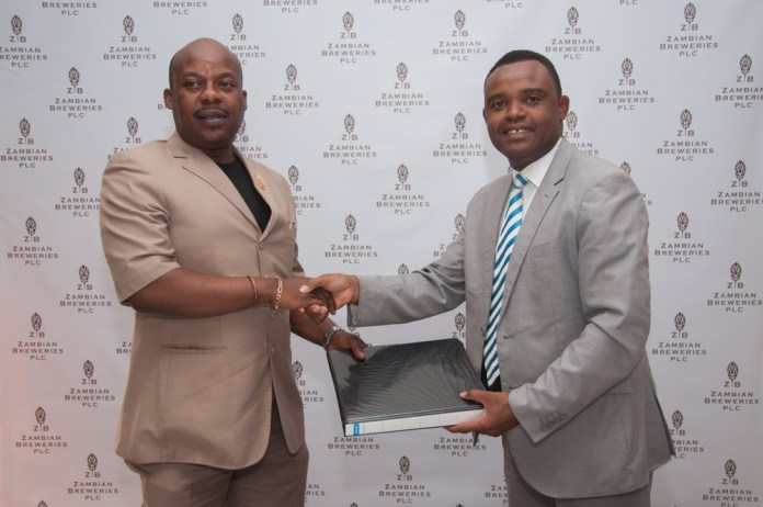 RTSA Chief Executive Officer Zindaba Soko, left, and Zambian Breweries Corporate Affairs Director Ezekiel Sekele agree an MOU on road safety.