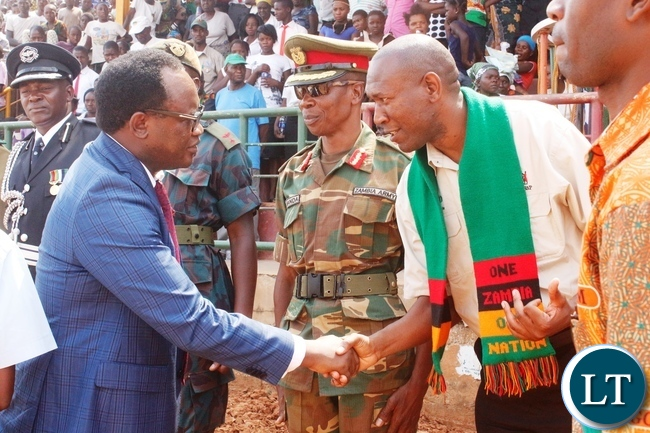 Northern Province Minister Brian Mundubile (left) and Kasama DC Kelly Kashiwa (right) on arrival at Kasama sports stadium to officiate at the 52nd independence day
