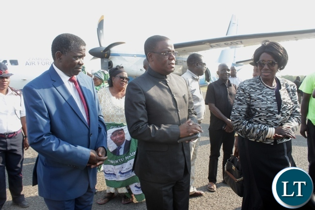 Vice President Inonge Wina (r) is being received at Mongu Airport by Western Province Minister Nathaniel Mubkwanu (c) and his Permanent Secretary Mwangala Liomba (l) for the funeral and burial procession of His Royal Highness the late Chief Lukama Meebelo Sekeld of Sioma and Shangombo Districts in Western Province