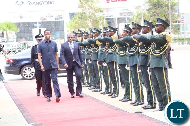 President Lungu flanked by Angolan minister of transport Augusto da silva arrives at the conference centre for the great lakes summit in Luanda 26-10-2016. .