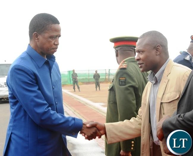 President Edgar Lungu(l) greets Patriotic Front Deputy Spokes Person Frank Bwalya(r) before departure for Morocco at Kenneth Kaunda International Airport in Lusaka