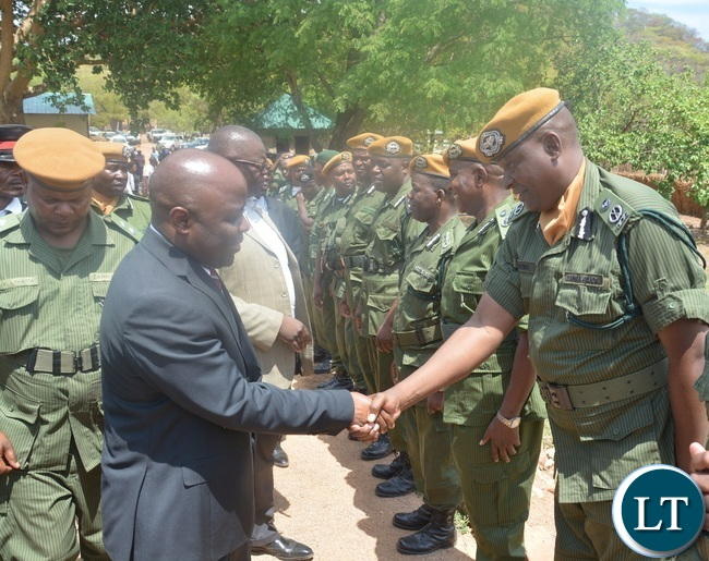 Minister of Home Affairs Stephen Kampyongo shake hands with State House Police Commissioner Chewe Bowa shortly after the 2015-2016 Pass out Parade in Geoffrey Mukuma Training School or called Sondela in Kafue District
