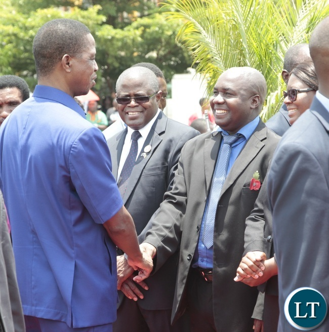 President Edgar Lungu shake hand with Southern Province Minister Edify Hamukali during the Remembrance Day at the National Cenotaph yesterday 13-11-2016. Picture by ROYD SIBAJENE/ZANIS