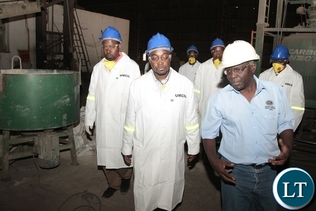 Minister of Transport and Communications Brain Mushimba and Universal Mining and Chemical Industries Limited (UMCIL) Kafue Steel Executive Technical Director Julius Kaoma tours the Kafue Steel Plant