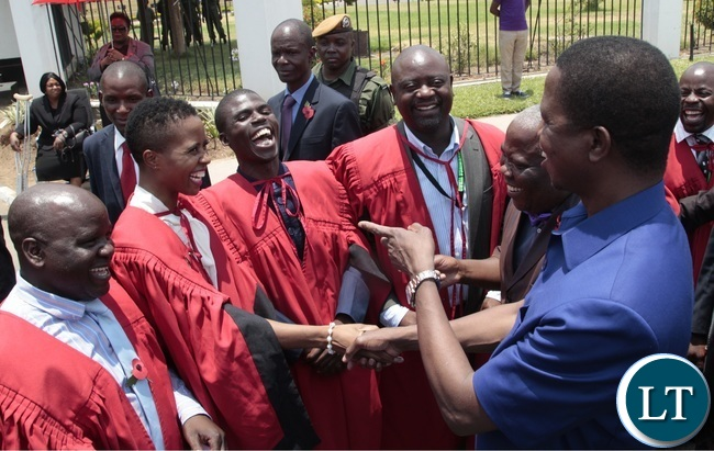 President Edgar Lungu shakes hands with his daughter Tasila Lungu councilor whilst other Councillors having a light moment during the Remembrance Day at the National Cenotaph yesterday 13-11-2016. Picture by ROYD SIBAJENE/ZANIS