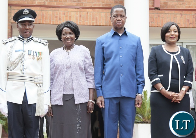 President Edgar Lungu and Vice President Inonge Wina pose for photo with congratulates Newly appointed Minister of Information Kampamba Mulenga (r) Northern Province Police Commissioner Richard Mweene (l) at State House