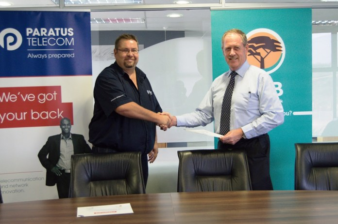 Paratus Telecom Zambia's Country Manager Marius van Vuuren and FNB Zambia Chief Executive Officer Leonard Haynes renew their contact to provide reliable high-speed internet services to the bank.
