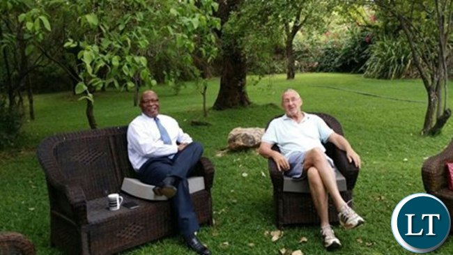 Dr Guy Scott relaxing at his farm house with Dr Nevers Mumba