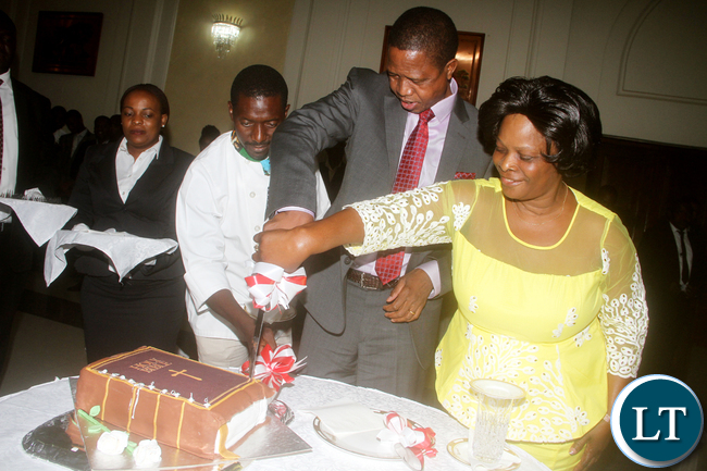 President Edgar Chagwa Lungu being helped to cut a cake by First Lady Esther Lungu during his 60 th Birthday celebrations organised for him by well wishers and state House staff Friday,November 11,2016-Picture by THOMAS NSAMA
