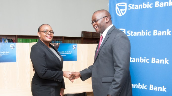 Stanbic Bank Zambia head legal and company secretary Doris Tembwe hands over new study cubicles to Attorney General Likando Kalaluka on behalf of Zambia Institute of Advanced Legal Education (ZIALE).