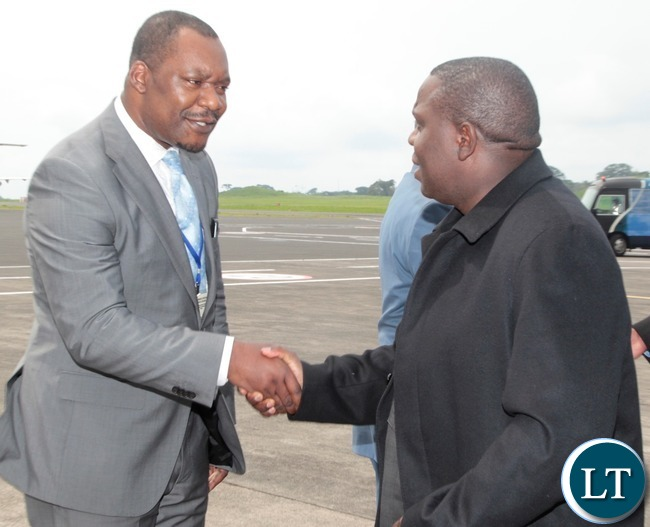 Foreign Affairs Minister ,Hon Harry Kalaba is welcomed by of Equatorial Guinea foreign Affairs Director Pendro Nguma at Malabo International Airport t