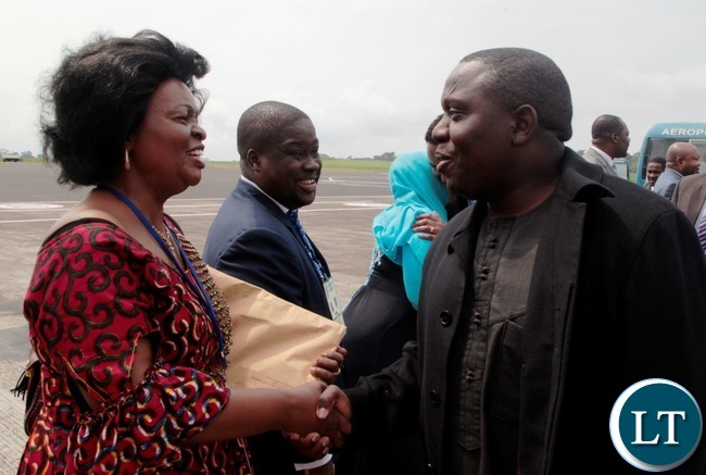 Foreign Affairs Minister ,Hon Harry Kalaba is welcomed by Zambia's permanent Ambassador to the African Union Susan Sikaneta at Malambo International Airport.